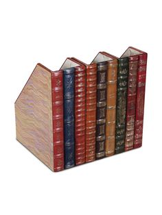 Book Spine File this would be easy to make just take the spines from old books hot glue them to wooden magazine holders that can be found at ikea or locale container store.