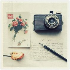 Buy a disposable camera and ask your pen pal to use it and then send it back. Calculate weight and postage.