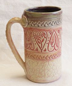 I like how this mug is long and thin. I also like the how the designs are carved into the mug. The natural coloring is very pretty.