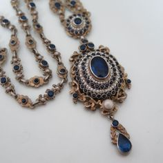 An antique Austro Hungarian sapphire paste and pearl necklace.