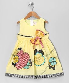 Pretty tulips will feel right at home in the sweet floral wonderland of this babydoll dress. Featuring a zip-up back with tie, floral appliqués and plaid bow embellishment, this piece is the perfect cozy garden for cuties to bloom in. Frocks For Girls, Cute Girl Outfits, Little Dresses, Lovely Dresses, Little Girl Dresses, Girls Dresses, Toddler Dress, Toddler Outfits, Baby Dress