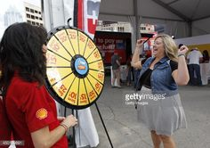 A race fan wins a prize after spinning the Spin to Save wheel from Shell. Buy this Prize Wheel at https://PrizeWheel.com/products/floor-prize-wheels/big-40-prize-wheel/.
