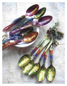 Kelli Nina Perkins's poetry spoons with alcohol inks