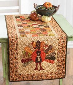 Let's Talk Turkey from Quilting Quickly Fall 2013 is a quilted table runner featuring a four patch checkerboard center and appliqué turkeys made from a dresden plate quilt block on both ends. Quilt by Jenny Doan.