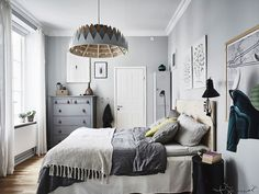 4 Essentials You Need To Create A Scandinavian Bedroom // Furniture -- Furniture is kept to a minimum in Scandinavian bedrooms. Dressers are used when necessary but clothes are usually kept in closets or on hanging rods displayed somewhere in the room.