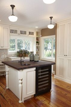 Island with wine cooler & sink