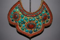 Tibetan (from the Indian Himalayas: Zanskar - Ladakh) breastornament called Skapak made of cloth, turquoise, red coral, agate and mother of pearl (24cm X 28cm). This ceremonial gorget was made in mid 20° century. It was worn around the neck by a superior Lama during ceremonies. Reference: Ethnic Jewelry, The René van der Star Collection, The Pepin Press, pag. 171 Price: on request. For more information, please email  didiergregoire03@gmail.com