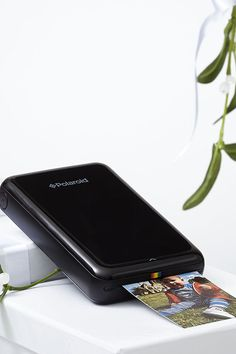 Polaroid Zip Instant Mobile Bluetooth Printer. All your favourite moments together printed in less than a minute with the new Polaroid Zip Instant Mobile Bluetooth Printer. You can print color photos in less than a minute from your phone or tablet via Bluetooth or NFC technology.