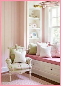 Pink and green room with built in window seat and shelves...