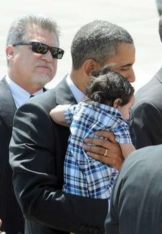 Pres. Barack Obama cradles Dalton Bast, four months, son of Jason and Tugba Bast, while he greets invited guests at the Nevada Air National Guard base