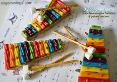 Rainbow Twizzler Xylophone Treats    The mallets are made from pretzel sticks with a mini marshmallow as the top.  So simple! @sugarswings