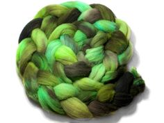 Beautiful soft and fluffy hand dyed wool tops or roving, perfect for spinners and felters. This one-off colour way includes a vibrant range of greens