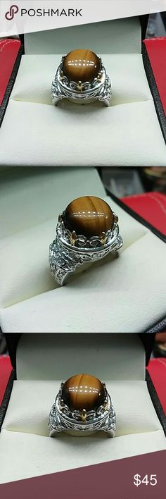 Genuine 6.2cts Tigers Eye 316L Stainless Steel Genuine 6.2cts tigers eye set in 316L stainless steel. Beautiful large size ring all natural gemstone in high grade stainless steel. Estate, size 7 estate Jewelry Rings