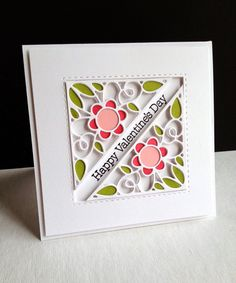 "I'm in Haven: PTI Ink Floral Flaps die.  Used 2 flaps, layered 3X & filled w color. Card 4 1/4"" sq.  Three flaps each for layering. Trim bottom two more than top one, so you don't see bottom layers. Adhere together. Die cut 3 colors for filling in. After putting pieces in, turn over. Use 1/16"" pop up squares & attach to back where there's a colored piece. Attach to a 4"" sq panel.  Stamp sentiment on piece of paper, & line it up to colored flaps panel, THEN attach WHOLE thing to card. 1/24/15"