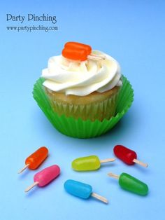 Cute popsicle cupcake toppers made from flat toothpicks pushed into Mike and Ike's. cute for a summer party