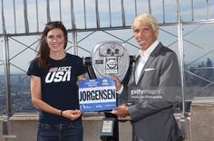 2016 Olympic triathlon gold medalist Gwen Jorgensen accepts her race bib from New York Road Runners President Peter Ciaccia at The Empire State Building on August 2016 in New York City. (Photo by Steve Zak Photography/WireImage) Gwen Jorgensen, Olympic Triathlon, Race Bibs, Rio Olympics 2016, August 25, Road Runner, Empire State Building, Role Models, My Idol