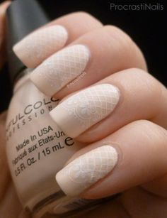 For a delicate design, use a lace pattern nail stamp with a nude base polish and white stamping polish. #NailArt #NailDesigns