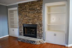 Stacked stone fireplace with built ins-all it needs is a mantel and flat screen tv above it. Yes please!!