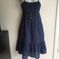 NWT adorable navy eyelet dress with side pockets. Cute and perfect. Firm unless bundled. Thank you for understanding.  StylesbyS Dresses Midi