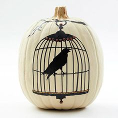 Birdcage Pumpkin Design  A dramatic white pumpkin lends a lovely backdrop for a birdcage design. Cut the pattern from vinyl and attach it for a no-carve way to celebrate Halloween.  Folow picture link to get the birdcage pattern