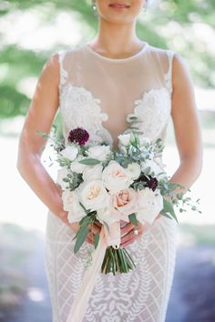 Blush bridal bouquet with pops of burgundy, structured with organic hints of eucalyptus. White o'hara garden roses, quicksand roses and white ranunculus. Photography by Blush Wedding Photography