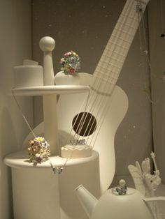 A photo of a music themed jewelry display at Dior in Paris.