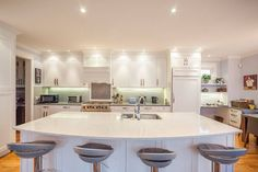 Modern White Kitchen With Light Aqua Subway Tile Backsplash. Simple And  Clean White Countertop By