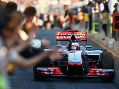 McLaren's Jenson Button wins the first race of the 2012 F1 season.