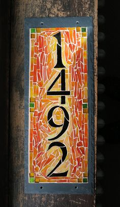 Vibrant Orange and Yellow Ochre Custom Vertical House Number by Nutmeg Designs for a Mission Style House in California, glass on slate, 6x15 inches.