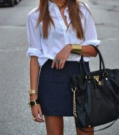 fashionable // white button down shirt, short skirt and an over sized handbag