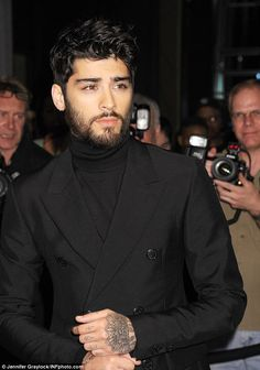 I'll be there for you: Zayn Malik put on a brave face as he threw himself into the supportive boyfriend role at the star-studded Tom Ford New York Fashion Week party on Wednesday night