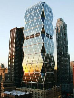 """Architecture: Hearst Tower by Foster and Partners: '""""..The building's symmetrically jagged silhouette is easily recognizable in its surroundings. The diagrid facade comprised of triangulated steel frame was designed to use 21% less steel than traditional buildings of it's type. Also impressive is the statistic which states that 90% of the 10,480 tons of steel used is derived from recycled material..""""  Iconic Foster and Partners.."""