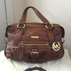 Authentic MK cognac color bag. With gold trim. Has plenty of pockets both on the outside and inside. Used for about one week. Dust bag included. Firm unless bundled. 14 inches wide 10 inches long with a shoulder strap drop of 8 inches. Michael Kors Bags Shoulder Bags