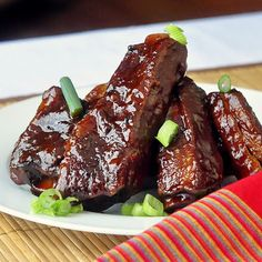 Maple Chipotle Barbeque Braised Ribs - slow cooked sticky ribs make great Superbowl grub!