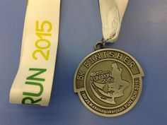 Medali finisher pertama