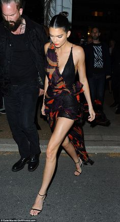 Arriving in style: Kendall Jenner looked incredible in a plunging patterned gown as she pa...