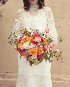 Dahlias, scabiosa, ranunculus, jasmine, roses and protea bring a pop of colour to your bridal look.