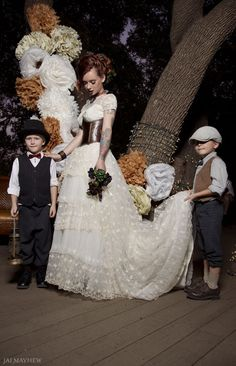 Steampunk wedding dress with cap sleeves and leather corset. aww look at those cute little boys I would love a pic like that