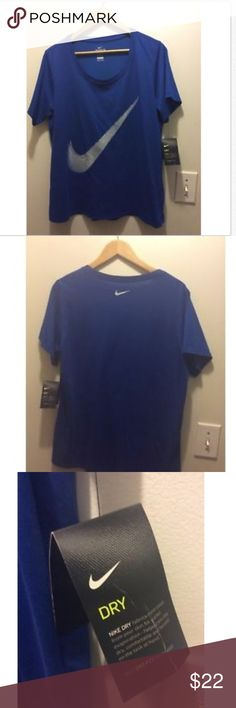 Plus Size Crew Neck Nike Dri-Fit T-shirt A great find with great style from Nike.  This is a 1X with an athletic cut meaning it's more fitted than a regular 1X. The color is royal blue (blue jay).  This item is new.  I accidentally crushed the vendor tag in transport but the shirt is perfect.  Only mentioning in case it is a gift.  See photo for detail.  Sleeve Length: Short Sleeve Fit: Athletic Cut/Fitted 58% Cotton 42% Polyester Machine wash Style 909796 Nike Tops Tees - Short Sleeve