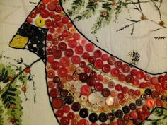 Vintage bird-button art. Don't think I'd choose a bird, but this would be an awesome way to use up tons of button stash.