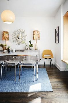 Lucite Chairs with white dining table