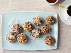 The No Bake Chewy Truffle Cookies from The Food Network are made with fairly healthy ingredients including dates, honey, reduced-fat peanut butter, oats and whole wheat graham crackers. Tip: Add more cocoa powder or some melted dark chocolate for a more chocolate-y taste.  #healthyrecipes #healthydesserts #healthycookies