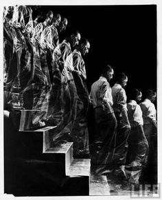 """Artist Marcel Duchamp walking down a flight of stairs in a multiple exposure image reminiscent of his famous painting """"Nude Descending a Staircase."""" Location: New York, NY, US Date taken: 1952 Photographer: Eliot Elisofon"""