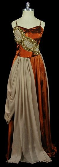 This gives me an awesome idea for attaching a train to a dress, starting at the bodice front