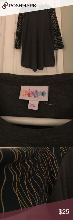 Lularoe Green Sleeve Randy Tee Gray size XXL 3/4 Sleeves. This is in excellent condition. Washed per LLR. Thanks so much for checking out this item today! We know that the shipping price is kinda ridiculous, so we suggest you bundle to get more for your money! You will also be saving money as well! Check out our bundle discount below! 💰reasonable offers welcome! LuLaRoe Tops Tees - Long Sleeve