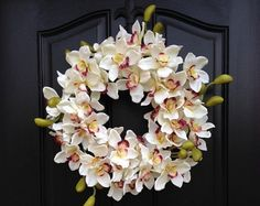 SUMMER Orchid Wreath, Summer Orchids, Year Round Wreath, Front Door Decor, Door Wreaths, Summer Inspirations, Summer Wreaths, Summer Decor  This beautiful summer orchid wreath would brighten any door front or room in your home. It would also look lovely as a centerpiece on your patio table.  This wreath measures approx. 19 in diameter and 8 deep. This creation is created with an abundance of artificial, gorgeous white orchids.  Other beautiful orchid wreath option: https://www.etsy....