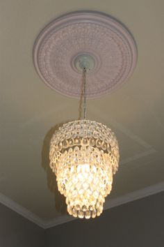 I like the idea of this against a gray ceiling with a white ceiling medallion and chandelier for a nursery.