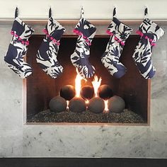 Navy Otomi stockings with pom-pom trim hanging on the mantle, yes please!