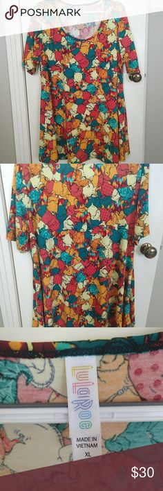 "Nightmare Before Christmas Mr. Oogie Boogie top Nightmare Before Christmas LuLaRoe Perfect-T starring Mr. Oogie Booggie!  Mr Oogie Boogie is all over this shirt in shades of orange, red, teal, and cream colors with some small patterns on him also (see close up picture)  Excellent used condition, worn just a couple hours.  Perfect-T is A-line with slight high-low hem and side slits. Approx measurements: 31"" long front, 32"" long back, 21.5"" armpit to armpit. LuLaRoe Tops Tees - Short Sleeve"