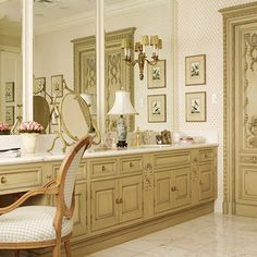 Inspired by the ornately carved closet doors, which came from a French chateau, the cabinetry sports a decorative paint treatment that mimics the original mustard-taupe finish and blue highlights of the antique doors. Open Bathroom, Bathroom Ideas, Master Bathroom, Antique Doors, French Decor, Bath Decor, Bathroom Styling, Better Homes And Gardens, Beautiful Bathrooms